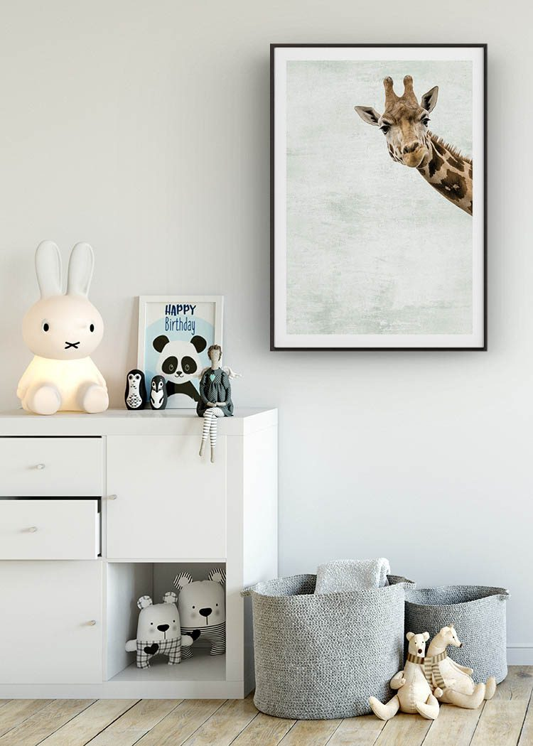Giraffe print in frame in teenager's room with dresser and textile dolls