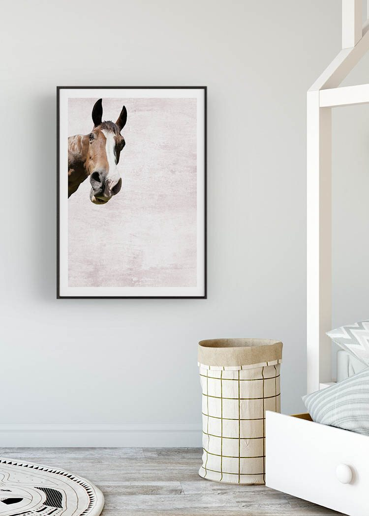 Horse print in black frame in kid's room with bed and graphic print mat