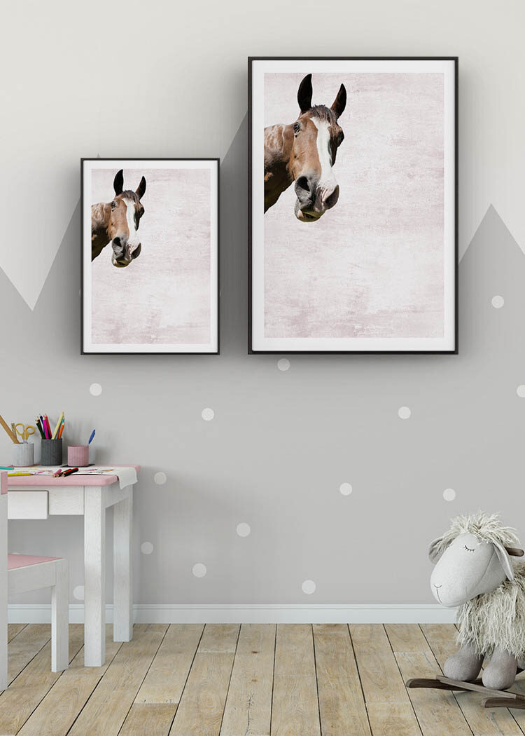 Posters with horse on purple pink background in child's room with tiny desk and rocking sheep