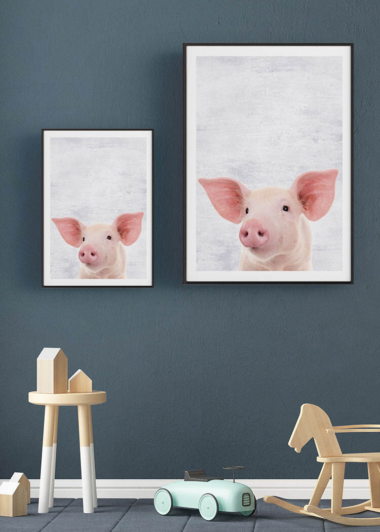 Posters with piglet on dark blue gray wall in child's room with wooden toys