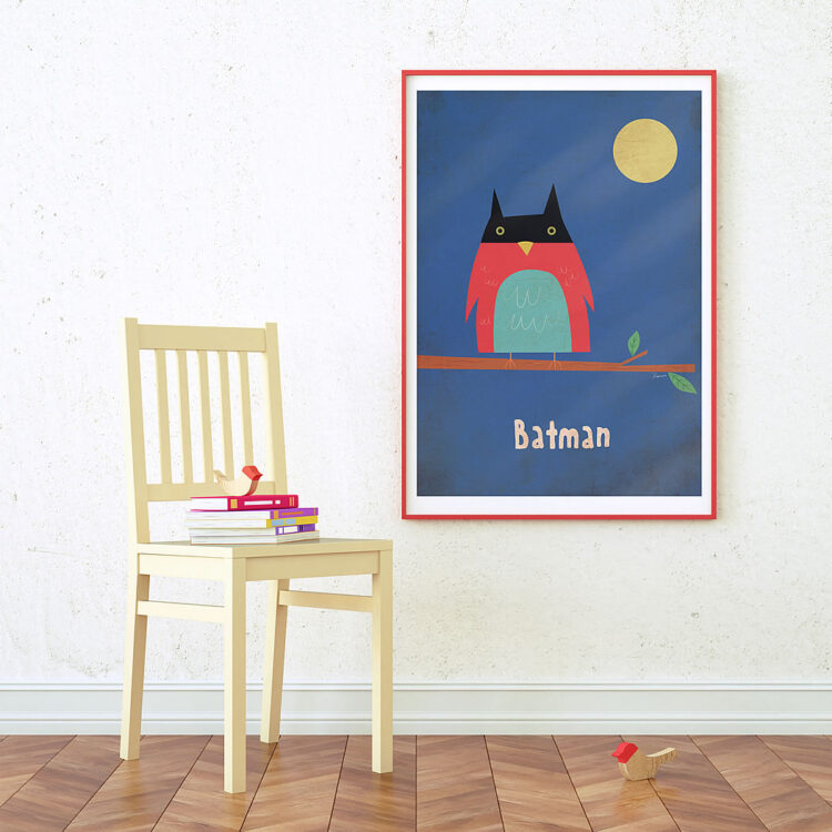 Batman poster in red frame next to yellow chair
