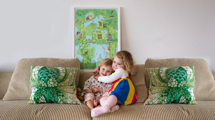 Sofa with two children and the poster The Tree House