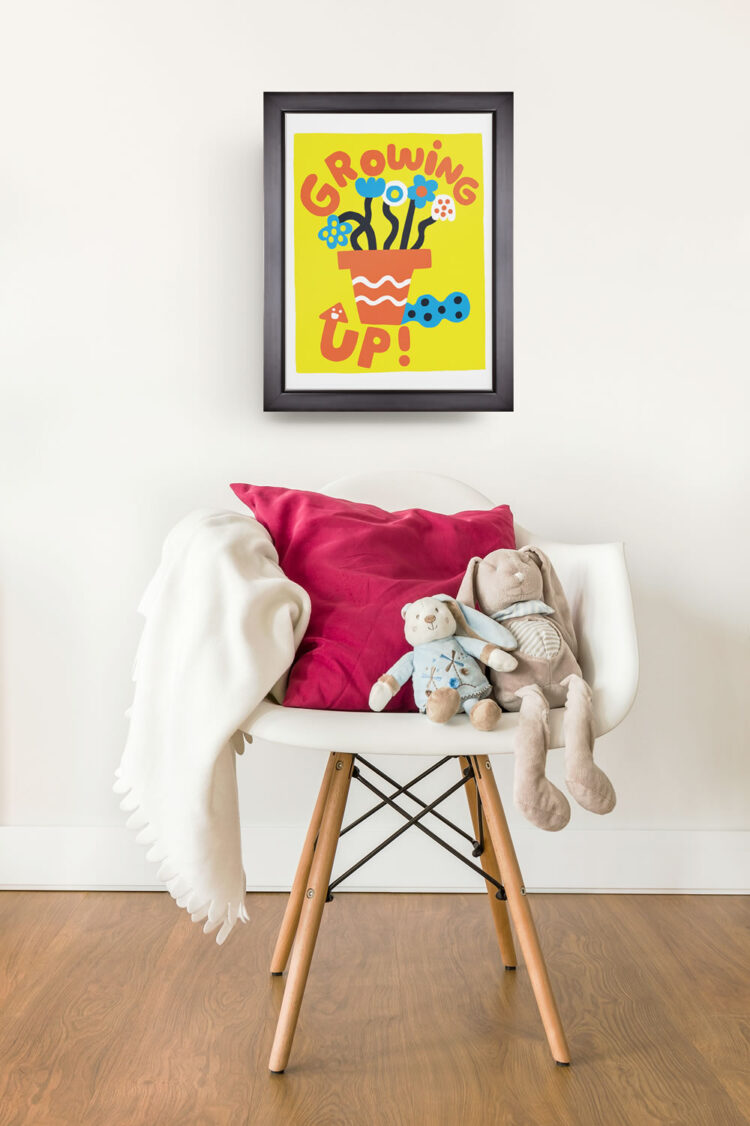 Growing Up! Graphical poster above Eames Eiffel Bucket Chair with blanket