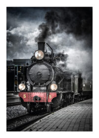 Black and white steam train with red details and black smoke and black train waggons on train station in Sweden