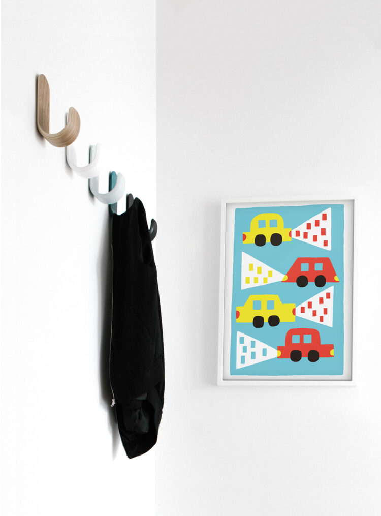 Cars poster in entrance area with jacket on wooden hangers
