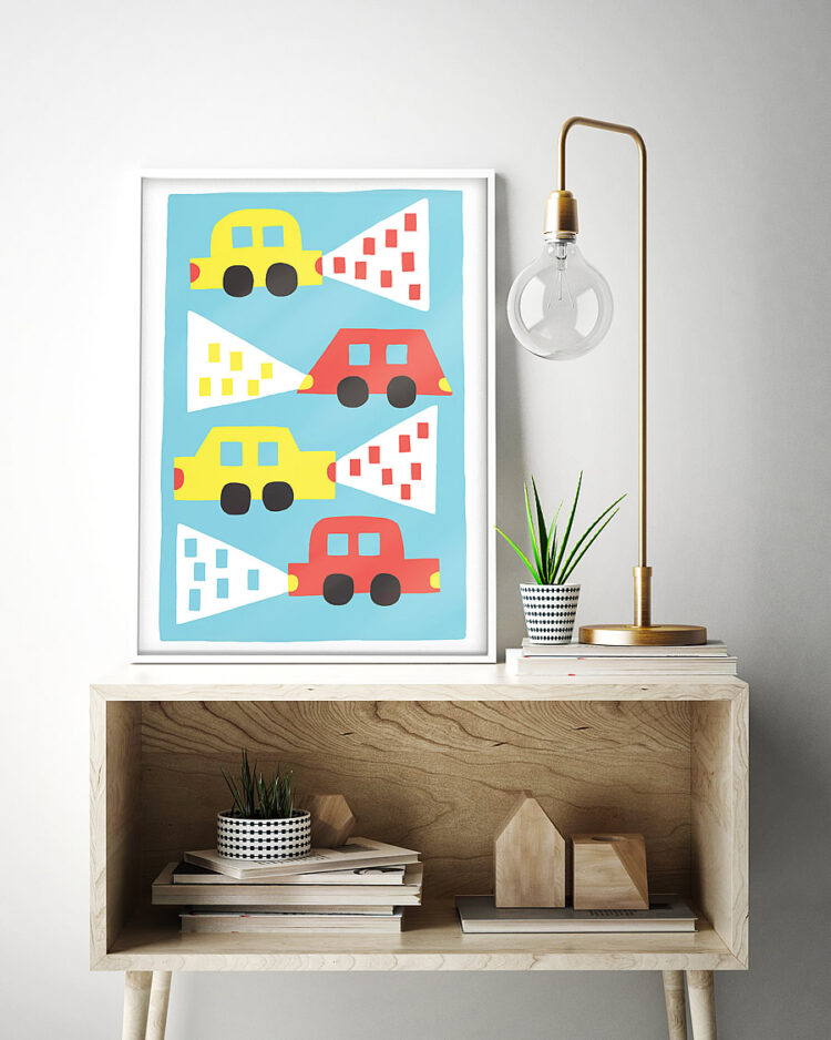 Cars poster in frame on ash coloured wood sideboard