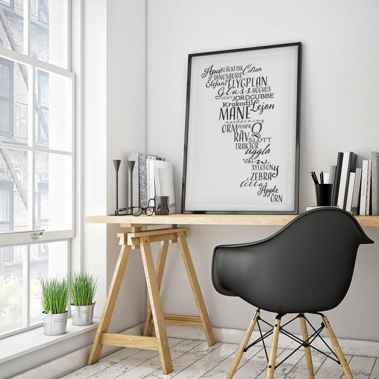 Swedish words poster - orm, xylofon, äpple - on desk with black chair