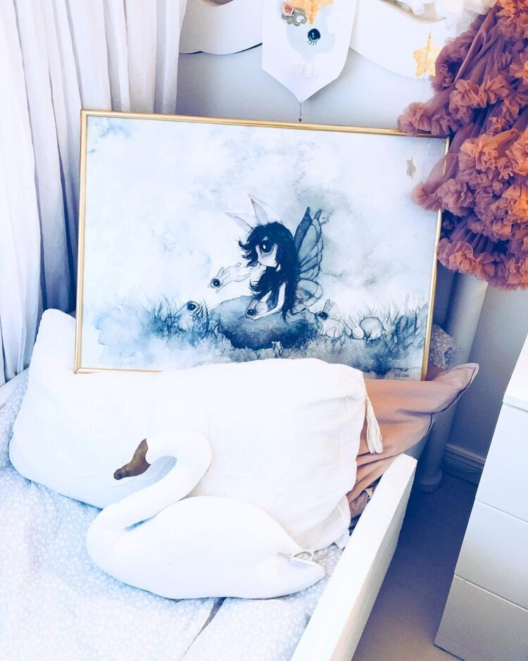 The rabbit girl poster in gold frame staning in kid's bed by @nellieandnikki