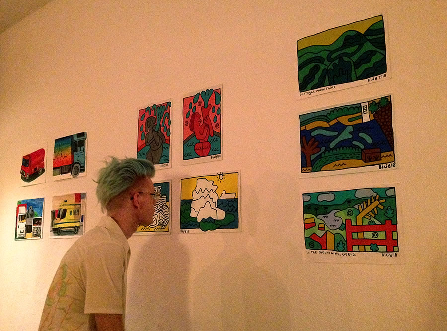 Björn in front seven of of Billy's pictures focused on painting of iceberg on blue ocean