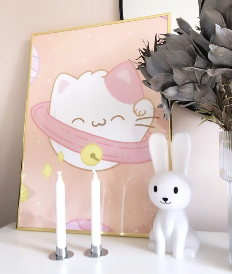 Pawluto in golden frame next to ceramic rabbit and candle stick holders by @nellieandnikki