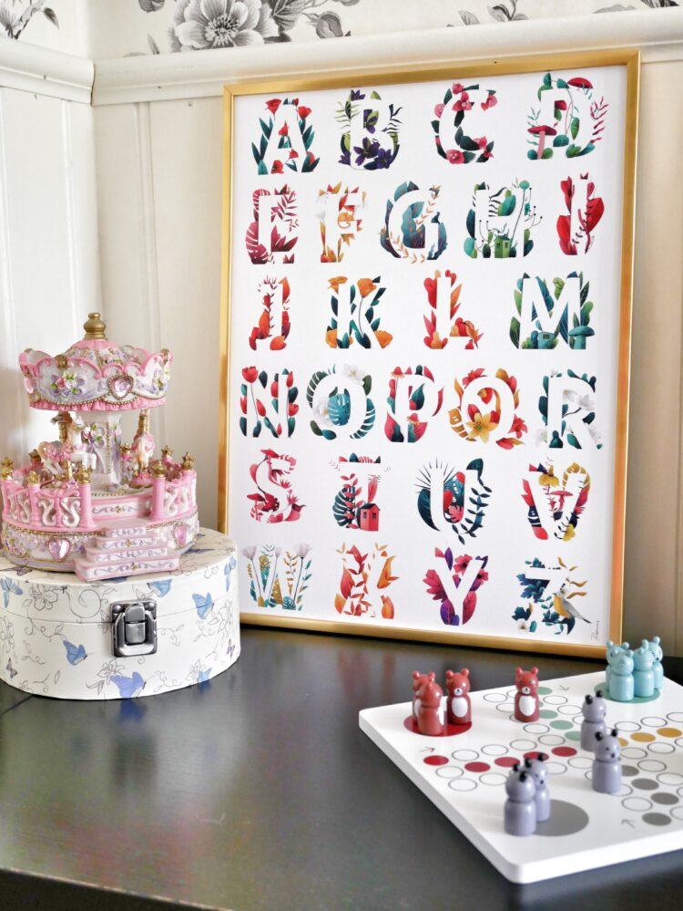 A Forest of Letters on kidsroom table with carousel, box and boardgame by @mariagarciacarrasco