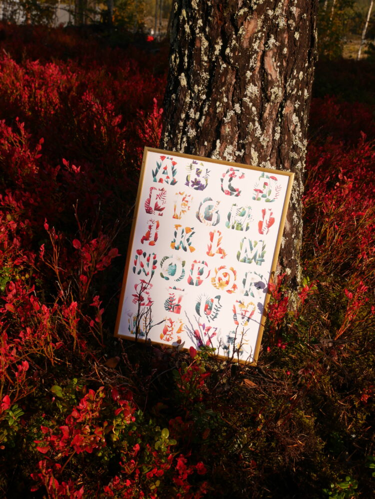 A Forest of Letters leaning against tree in autumn forest by @mariagarciacarrasco