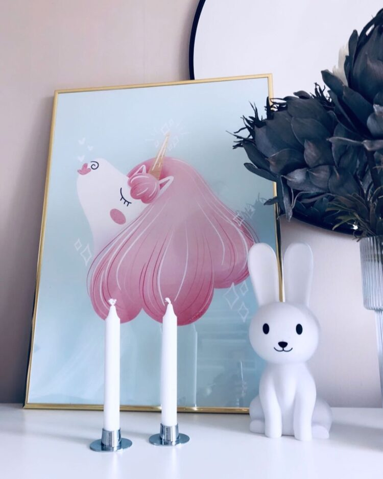 Pretty Unicorn poster on sideboard with rabbit statue by @nelliandnikki