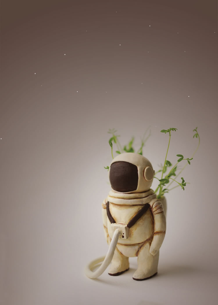 Clay figure astronaut with plants in backpack by Elisabeth Karin
